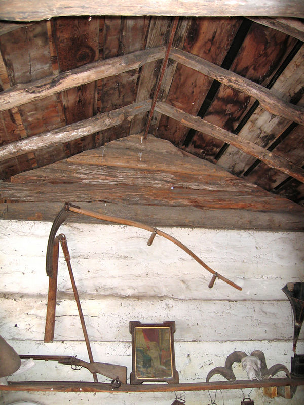 Inside the cabin.  There is no insulation.  The walls were covered with what looked like clay, giving the them a smoother, lighter finish than simple rough wood would give.