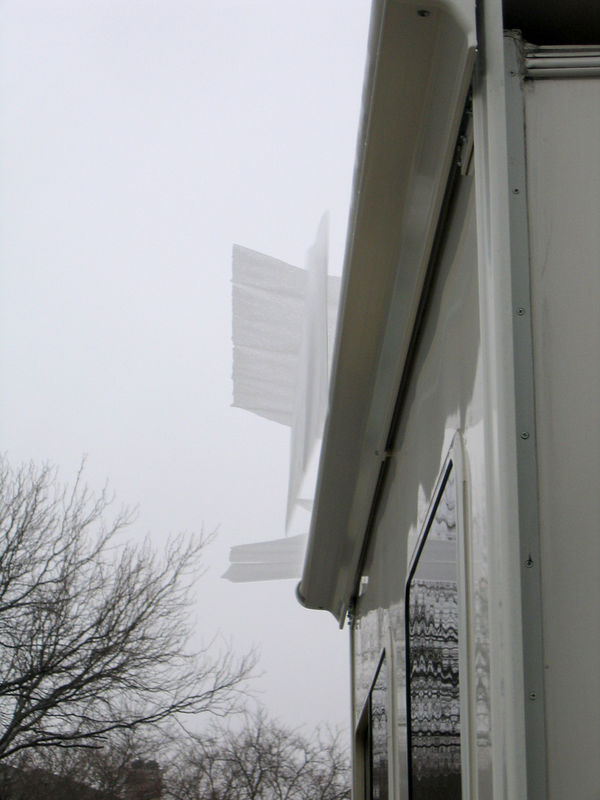 You can see the sheets of ice being pushed off the slideout awning as the slideouts are being retracted.