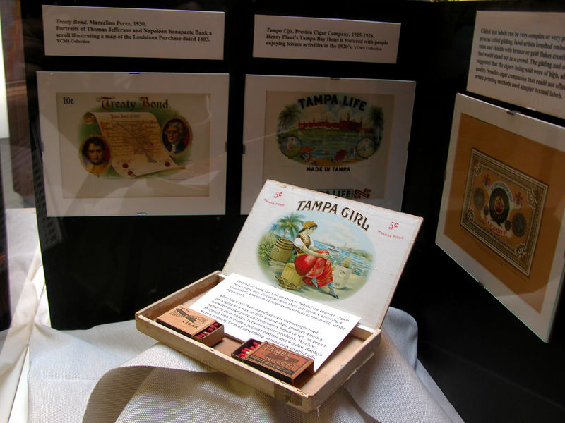 At the turn of the century cigar boxes were elaborately decorated and put out on shelves instead of behind the counter.