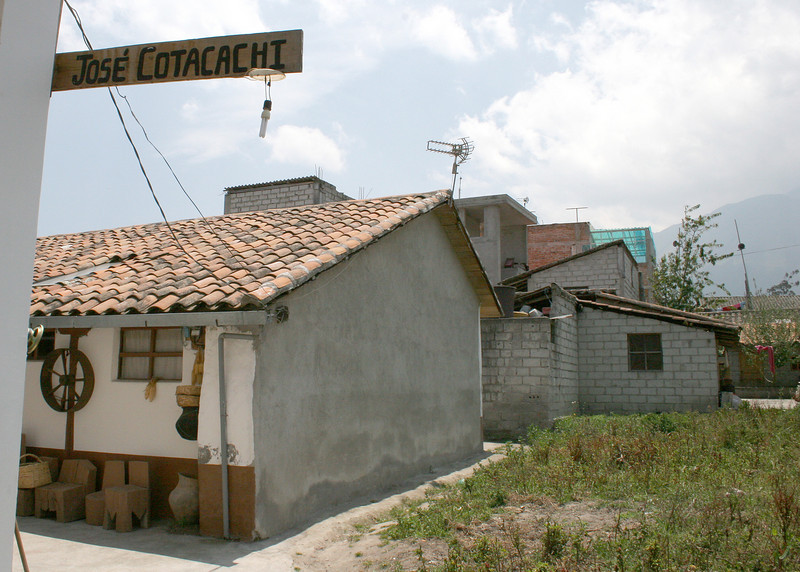"This is a sign leading to Jose Cotacachi's showroom.  <br /> <br /> Jose Cotacachi is one of the most renowned weavers of Ecuador.  If you would like to see more of his work, here is a link:  <a href=""http://www.josecotacachi.com"">http://www.josecotacachi.com</a>"