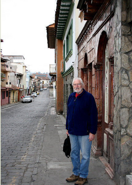 """The streets in """"Old Town"""" Cuenca are narrow and cobblestone.  Some of the sidewalks are very narrow as well.  Here is Mike on one of those sidewalks."""