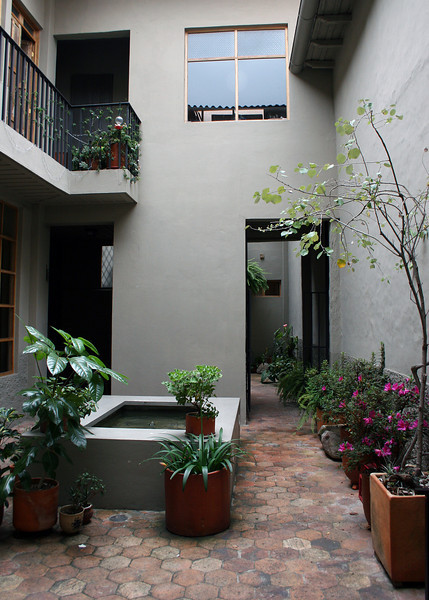As you walk in door  you go through a courtyard and past the entrance at the back right.  There is a room upstairs, which we had and one on the ground floor.