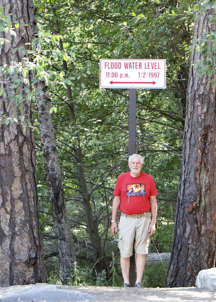 Mike at sign showing where the flood waters were in 1997