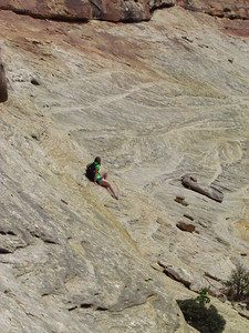 Allie contemplating steep slickrock