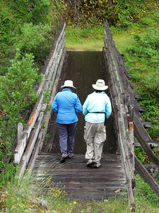 Willy & Jane crossing a bridge over Mule Creek, up from Rogue River Ranch.