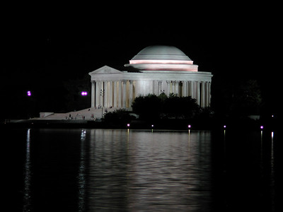 """Now it is decision time.  We wanted to see the Jefferson Memorial but looking at the map I can see it probably is not as close at it looks (we can see it through the trees though).  What the heck, let's go for it.  ***   Walk, walk, walk.  We soon leave all the other tourists behind.  Walk, walk, walk.  Now we are to the edge of the reflecting pool and can see it across the otherside.   I have to stop and get a picture.   I setup the tripod, and start to fiddle endlessly with settings.  Even in my """"camera transe"""" as Ryan calls it, I hear the rumblings of discontent... that's ok, I just concentrate harder and am soon back in CT mode.  After getting a decent shot, I notice I've been left behind."""
