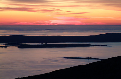 We get up bright (dark?) and early at 5:30, grab a quick bite to eat, and head off to Cadillac Mountain.  On the way up the mountain the sky was already changing from darkness to a deep blue with a rosy glow building at the horizon.  By the time we got to the top the colors were already incredible.  Probably the best sunrise I've ever seen and photographed.