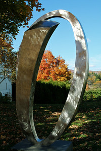 There was a sculpture exhibit in town- they had placed various metal sculptures in and around town.  This one makes an interesting frame for some fall color.