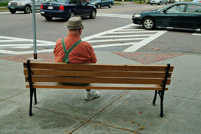 "Walking through town you got the feeling that you had stepped back in time  or was in a movie.  The people, buildings, and sights all matched the stereotypical ""New England Town"".   I can easily imagine this fellow sitting on this same bench 50 years ago."