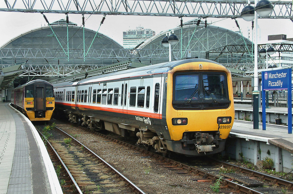 323237 and 158766, Manchester Piccadilly 11/6/2003