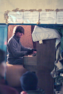 We were walking heading towards a crepe stand when we heard a piano playing.  Wanting to stand out from the standard instruments typically used by the street performers, this fellow put a piano in the back of his van and would just pull up to the curb, slide the door open, and start playing.
