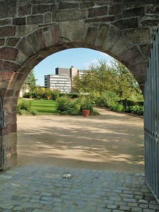 Gateway to the new...  I was strolling around a garden near the Marketplatz and found this view through an old arch looking out at the modern part of Leonberg.