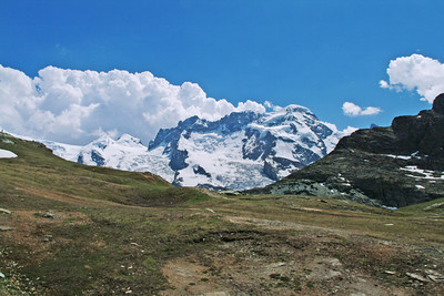 """This is the long ridge of the Breithorn and the """"Zwillinge"""" (""""twins"""") of Pollux and Castor with I believe the very tip of Klein Matterhorn (which we would be on top of the next day) visible poking above the ridge on the right."""