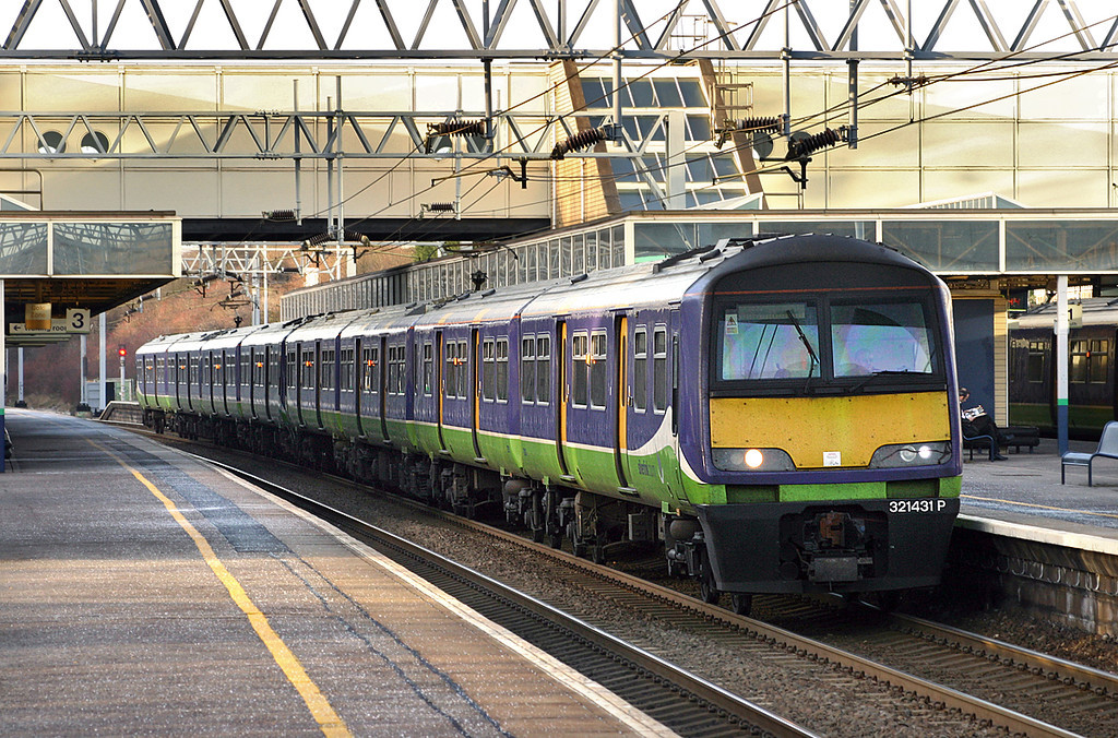 321431 and 321424, Milton Keynes Central 13/1/2005<br /> 2N38 1432 Northampton-London Euston