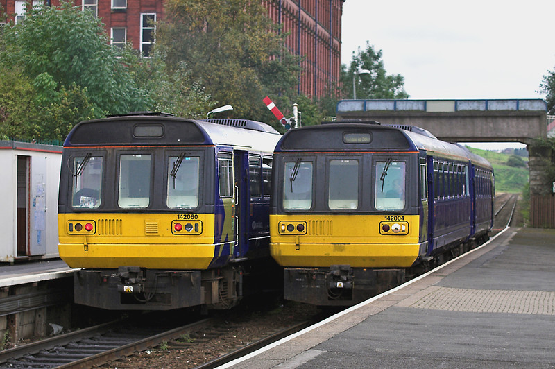 142004 and 142060, Shaw and Crompton 26/9/2005<br /> 142004: 2J86 1115 Manchester Victoria-Rochdale<br /> 142060: 2J91 1132 Rochdale-Manchester Victoria