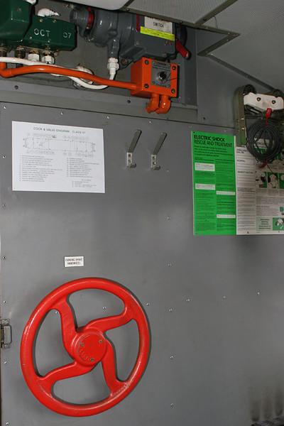 B: Bulkhead of Cab No.2 showing (bottom left) parking brake wheel, (top left) AWS equipment, (top right) track circuit clips