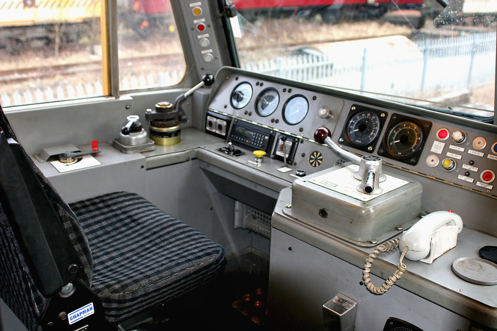 A: Cab No2 of 57303, Drivers side.<br /> From left to right: Brake Control Switch, Straight Air Brake, Proportional 'Train' Brake, fault lights, engine start/stop switches, air/brake guages, NRN radio, fire test button, wiper control, AWS reset, horn, AWS 'sunflower', Speedometer, Engine Rev Dial, Power Handle and reverser lever, Parking Brake condition light, ETS light and switches, Hazard warning light, NRN handset.