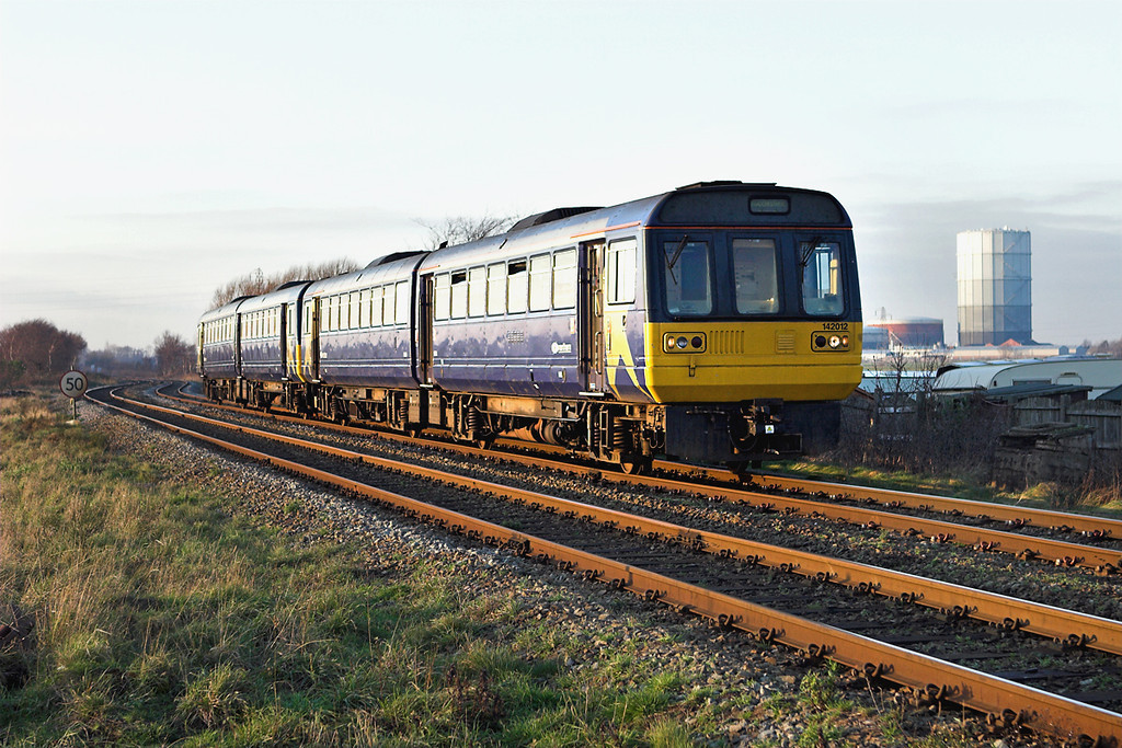 142012 and 142038, Scarisbrick 21/12/2006<br /> 2A42 1438 Southport-Manchester Airport