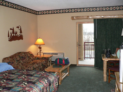 Picture of suite from the middle looking towards balcony.
