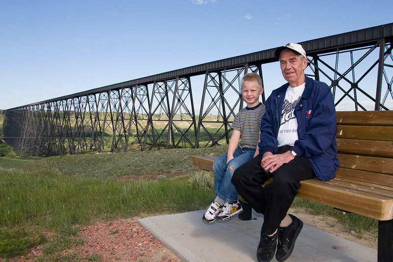 John sitting with Grandpa Ed with the CP Rail High Level Bridge in the background.