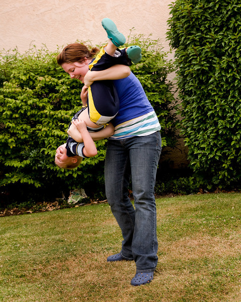 John and Kissanya playing around in the backyard.<br /> <br /> John later got his first nose bleed while driving to the mini golf course. Thanks Cousin Kissanya :P<br /> <br /> And no, he didn't get any blood on the Jeep. Good going John!<br /> <br /> (he was actually pretty concerned when he started bleeding - he's never had a nose bleed so he got a little freaked out)
