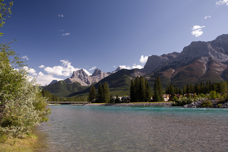 The Bow River, Canmore Alberta with the Three Sisters in the Background.