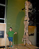 John standing next to a dinosour leg.