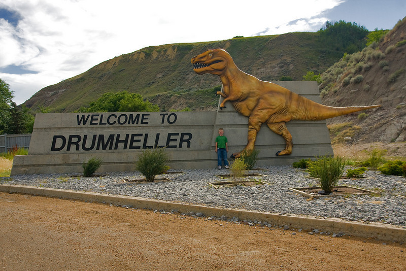 Driving down a hill, we saw this sign welcoming travellers to Drumheller so I thought I would stop and get a photo of John next to the dinosaur.