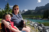 John and Wendy sitting on a bench enjoying the warm sunny day in Canmore Alberta.