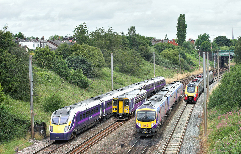 Four pictures merged, taken over space of 5 minutes.<br /> 180106, 153332, 185137 and 221142, Penwortham 5/8/2009<br /> 180106: 2N99 0922 Manchester Victoria-Blackpool North<br /> 153332: 2F06 1007 Preston-Ormskirk<br /> 185137: 1N58 0929 Manchester Airport-Blackpool North<br /> 221142: 1M51 0800 Glasgow Central-Birmingham New Street
