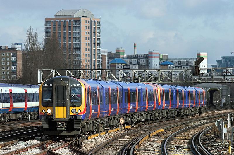 450112 and 450127, Clapham Junction 13/2/2009<br /> 2L31 1142 London Waterloo-Basingstoke