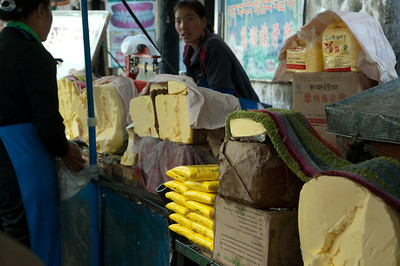 Yak butter for sale.  It is used by pilgrims to feed the many candles in the temples.