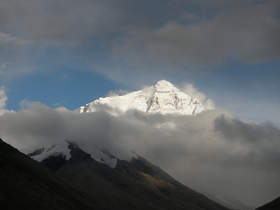 Mt. Everest (Quomolungma).  When we arrived at our hotel near the Rongphu Monastery, Mt. Everest was shrouded in clouds.  This looked like a bad omen for the start of our short stay in the Everest region.  But things just got better and better as evening settled in!