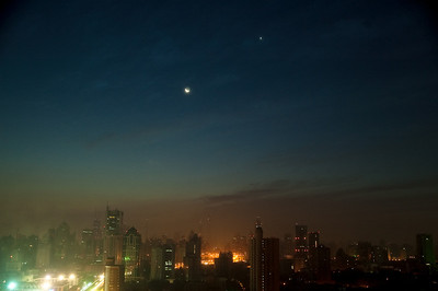 Moon & Venus over Shanghai -- the product of jet lag (taken at 4AM).  Mostly clear skies raised our hopes for seeing the eclipse we had come for, but generally the weather was looking bad for much of Asia.