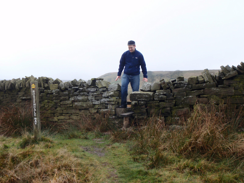 Nigel coming over a wall at the top of the hill