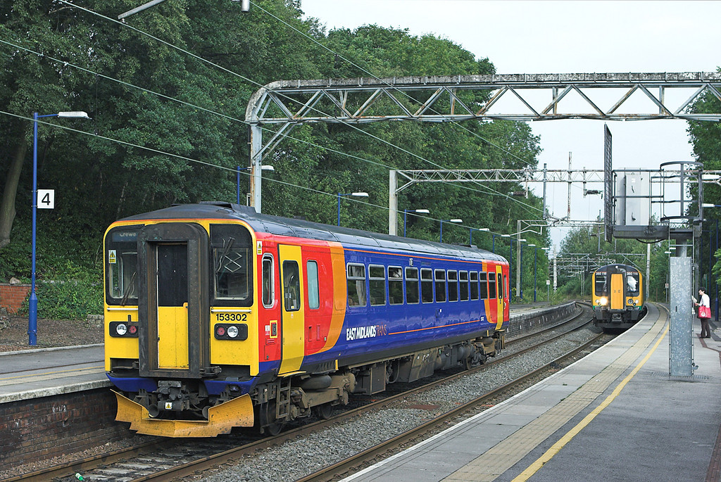 153302 and 350118, Kidsgrove 30/7/2010<br /> 153302: 1K02 0740 Derby-Crewe<br /> 350118: 1U24 0833 Crewe-London Euston