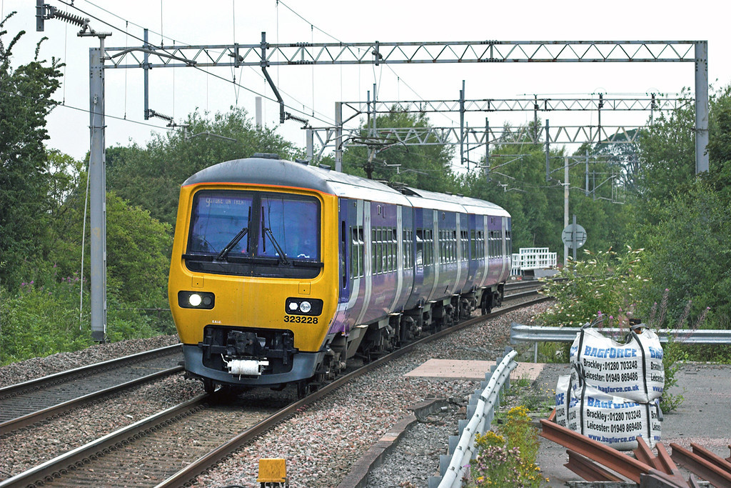 323228 Kidsgrove 30/7/2010<br /> 2K16 0848 Manchester Piccadilly-Stoke on Trent