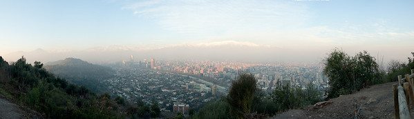 Sunset view of Santiago from Cerro San Cristobal.  The Andes are in the background.  Santiago is subject to fog and smog as it sits in a valley between the Andes and a coastal mountain range.