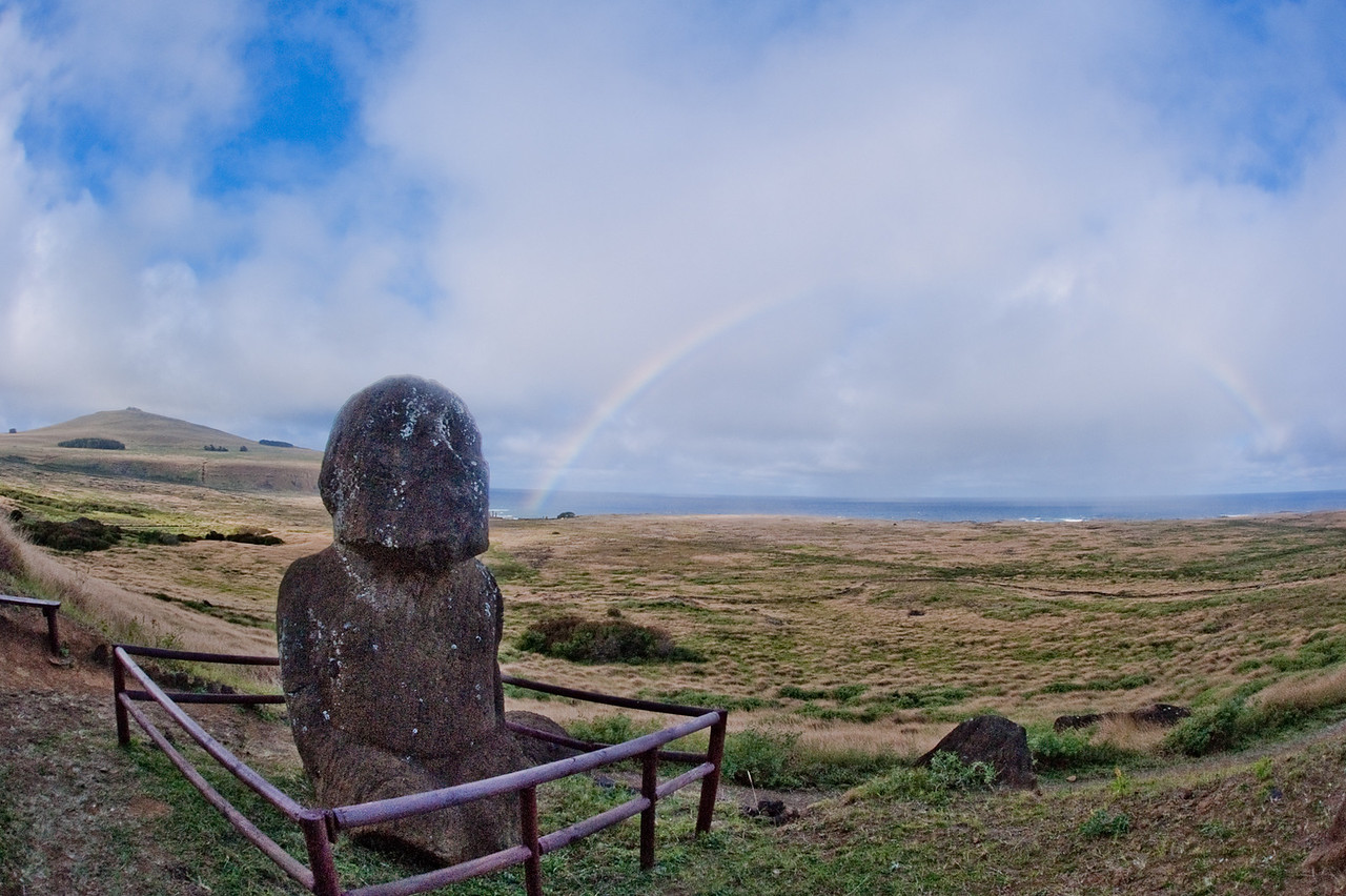 Moai at the quarry where the Moai were shaped before transport to platforms (ahu) by the beach. Cloudy/drizzly conditions gave us many chances to get rainbow photos.