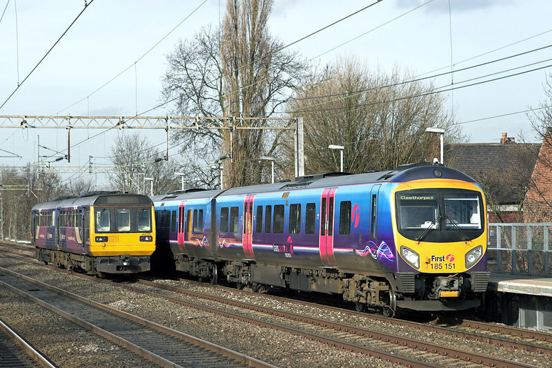 185151 and 142058, Levenshulme 24/2/2011<br /> 185151: 1B80 1355 Manchester Airport-Cleethorpes<br /> 142058: 2D46 1417 Manchester Piccadilly-Chester