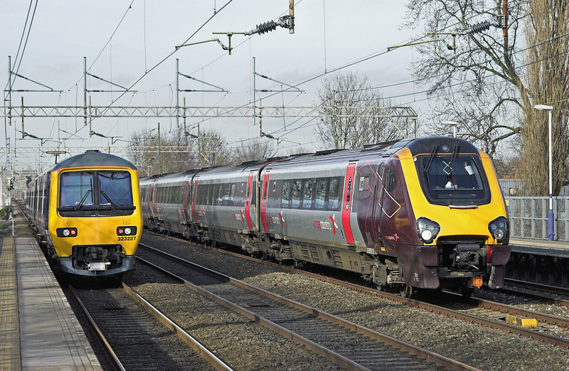221135 and 323227, Levenshulme 24/2/2011<br /> 221135: 1V59 1409 Manchester Piccadilly-Paignton<br /> 323227: 2H23 1348 Alderley Edge-Manchester Piccadilly
