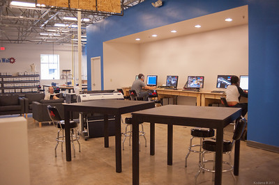 Another view of the lounge and workstations.  WiFi at all TechShops also makes it convenient to bring your own computer and work on it. [TechShop San Jose]