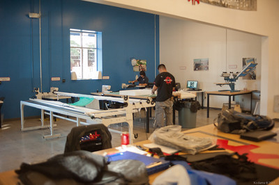 Sewing area, plus an NC vinyl cutting machine in the back. [TechShop San Jose]