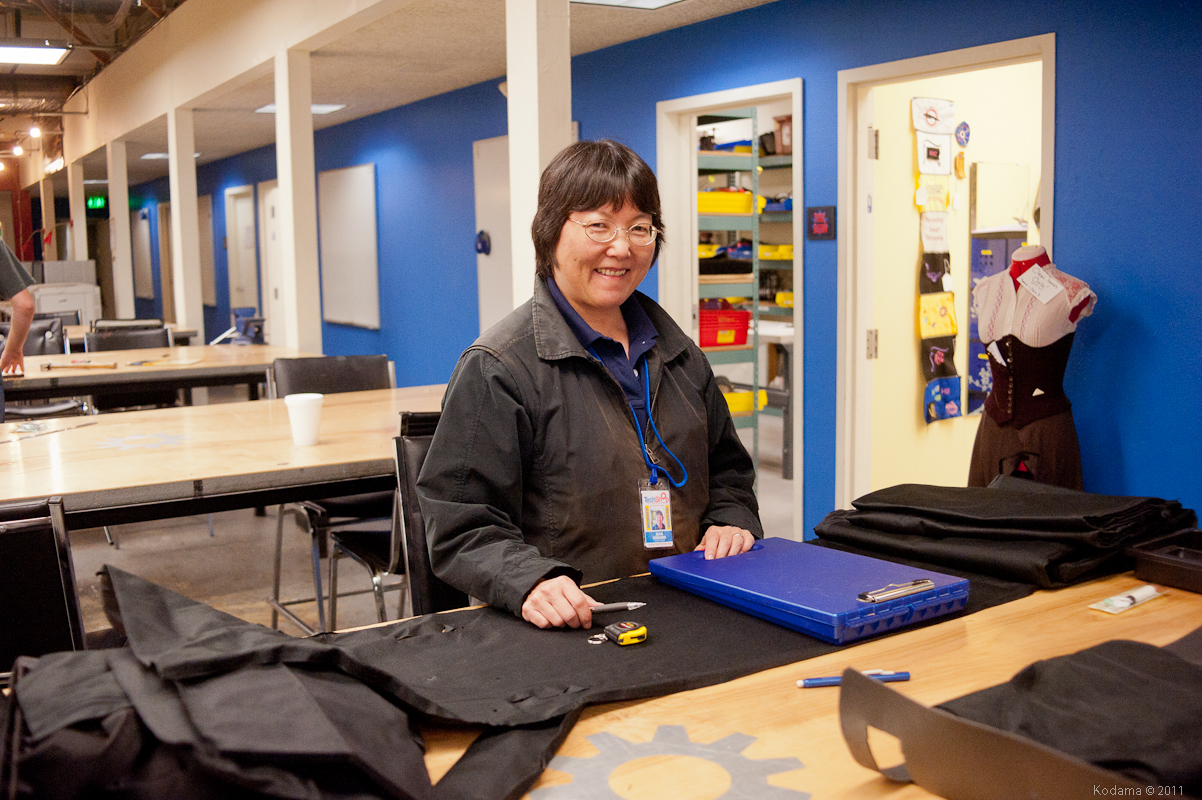 Jean works on her project - conversion of a commercial giant duffle bag into a customized bag for her kendo gear. [TechShop Menlo Park]