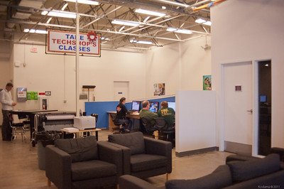 Lounge, computer workstations, and large format printer. [TechShop San Jose]