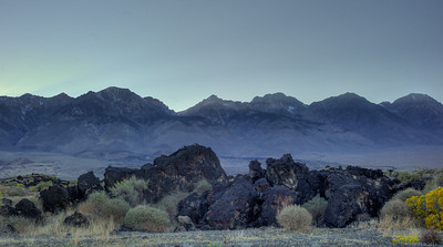 Remnants of a lava flow in the foreground, granite of the eastern Sierras in the background.