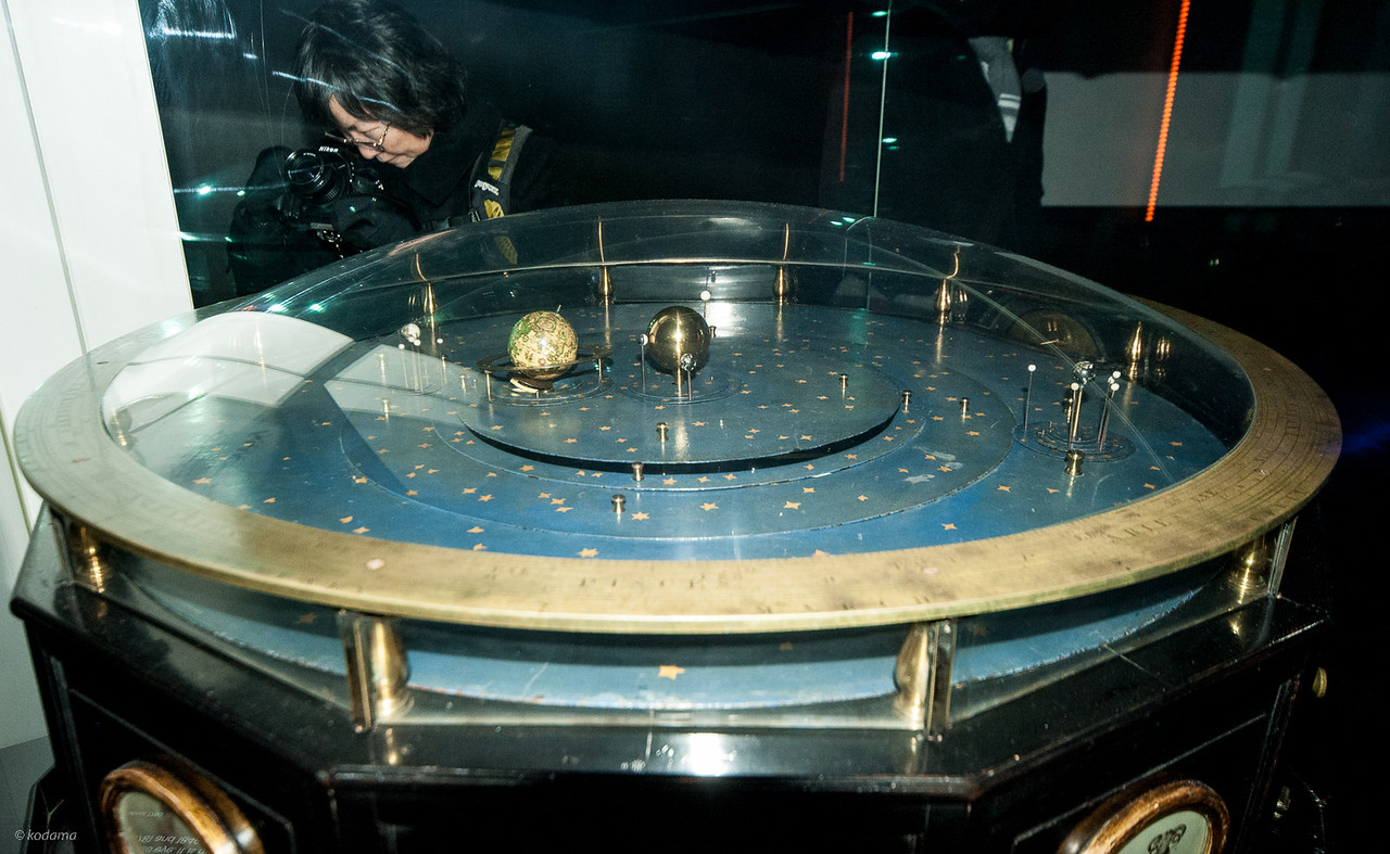 Orrery - a mechanical model of our solar system.  It's essentially a very complicated mechanical clock.