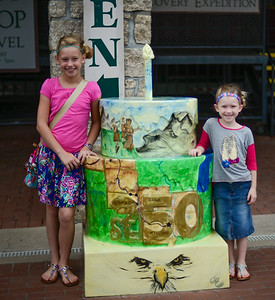 Emma and Ady at one of St. Louis' 250 year birthday cake (Lewis and Clark Boathouse)
