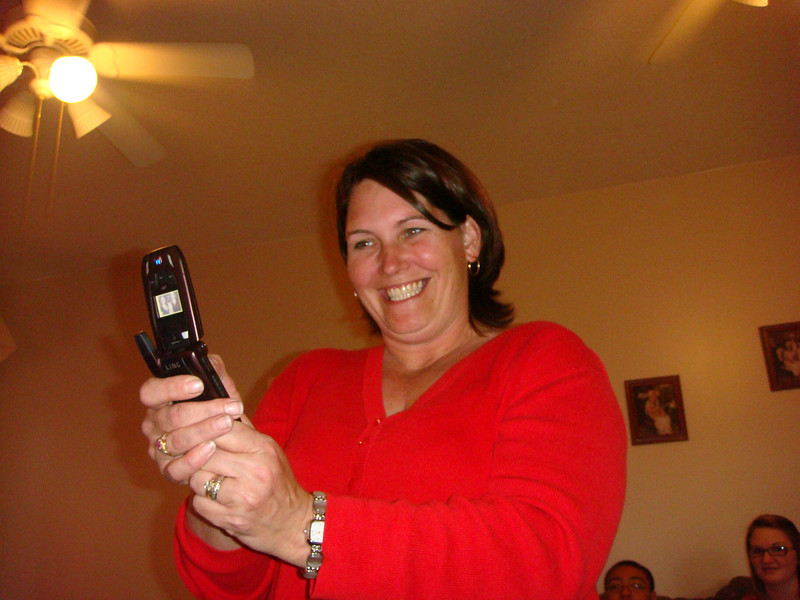 Visiting Amber's house on Christmas Eve. Amber taking a picture on her phone.