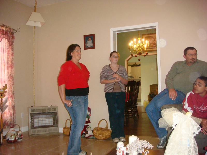 Visiting Amber's house on Christmas Eve. Amber, Christen, Chris and Caleb. That family is quite full of C-names.